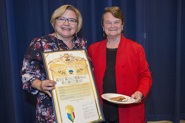 Executive Director Sarah Orth receives the commendation from Supervisor Keuhl