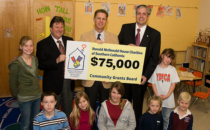 Children in a Classroom receiving a $75,000 Grant Check
