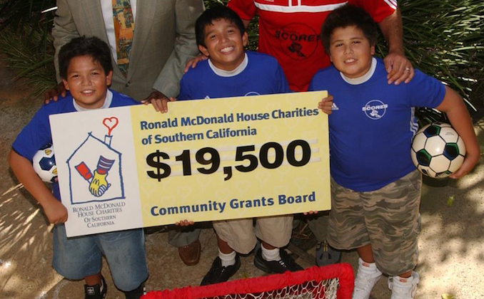Soccer kids receiving a RMHCSC Grant Check