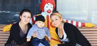 Family Posing by a Ronald Statue