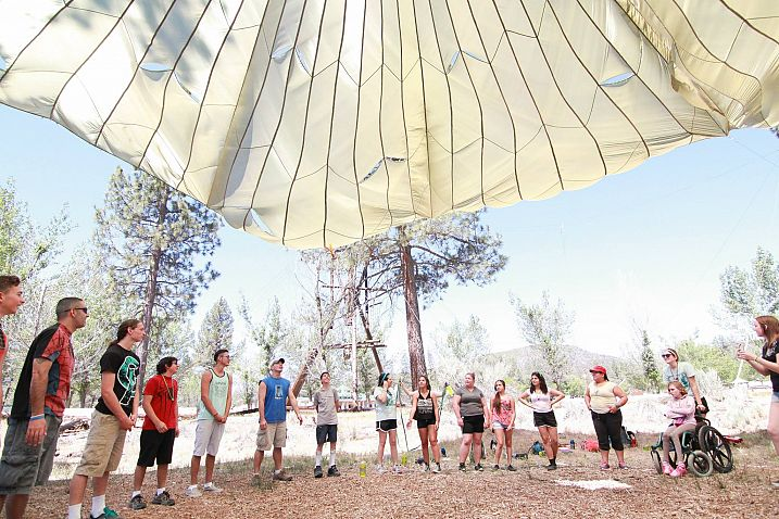 Campers Under the Large Parachute